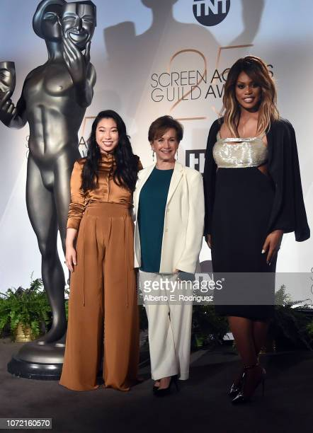 Awkwafina, SAG-AFTRA President Gabrielle Carteris, and Laverne Cox pose onstage during the 25th Annual Screen Actors Guild Awards Nominations...