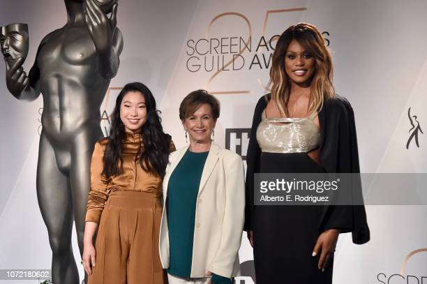Awkwafina SAGAFTRA President Gabrielle Carteris and Laverne Cox pose onstage during the 25th Annual Screen Actors Guild Awards Nominations...