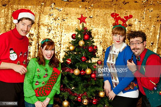 awkward christmas - ugly christmas sweater stock photos and pictures
