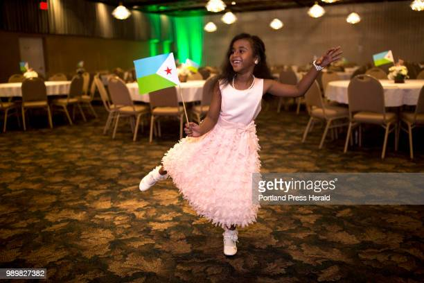 Awo-Ayan Mohamed of Westbrook, gets the party started early dancing with the Djiboutian flag before the crowd arrived to celebrate the country's 41st...
