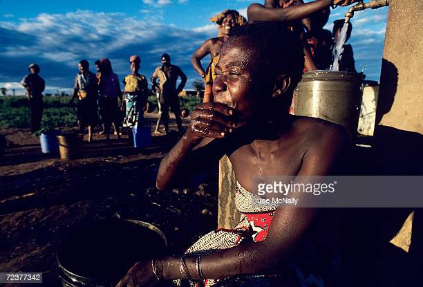 Awoman rinses her face which may have prevented the spread of tracoma in 1992 in Tanzania Six out of every ten children are infected in this region...