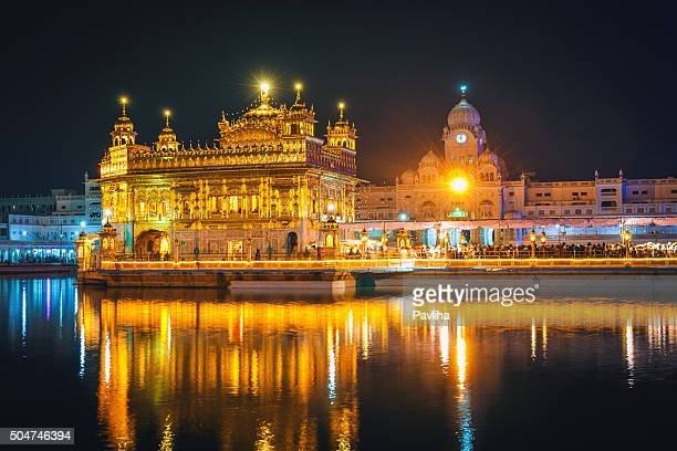 awsome sikh golden temple at night amritsar india - amritsar stock pictures, royalty-free photos & images