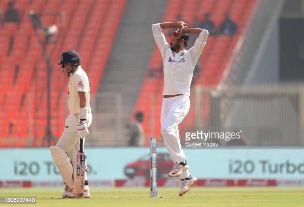 Axar Patel of India bowls watch on by Joe Root of England during Day One of the 4th Test Match between India and England at the Narendra Modi Stadium...