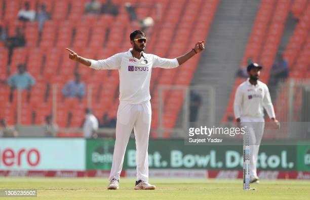 Axar Patel of India celebrates taking the wicket of Zak Crawley of England during Day One of the 4th Test Match between India and England at the...