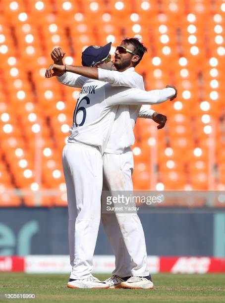 Axar Patel of India celebrates with Mayank Agarwal after taking the wicket of Dom Bess of England during Day Three of the 4th Test Match between...