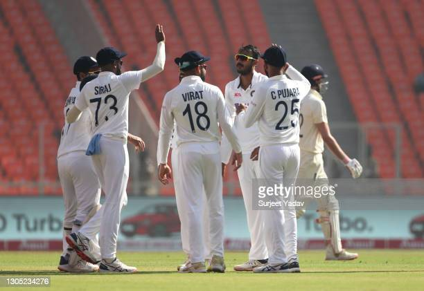 Axar Patel of India celebrates with Mohammed Siraj, Virat Kohli, Cheteshwar Pujara and teammates after taking the wicket of Dom Sibley of England...