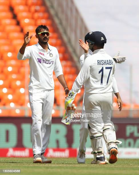 Axar Patel of India celebrates with Rishabh Pant after the wicket of Ollie Pope of England during Day Three of the 4th Test Match between India and...
