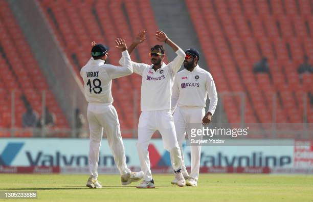 Axar Patel of India celebrates with Virat Kohli after taking the wicket of Dom Sibley of England during Day One of the 4th Test Match between India...