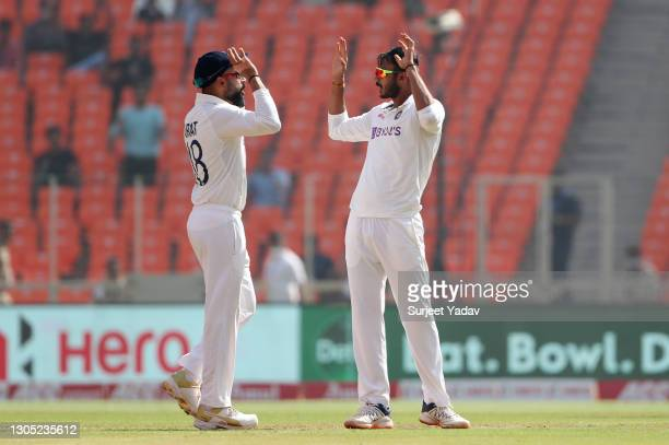 Axar Patel of India celebrates with Virat Kohli after taking the wicket of Zak Crawley of England during Day One of the 4th Test Match between India...
