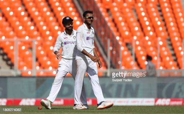 Axar Patel of India celebrates with Virat Kohli after taking the wicket of Dom Bess of England during Day One of the 4th Test Match between India and...