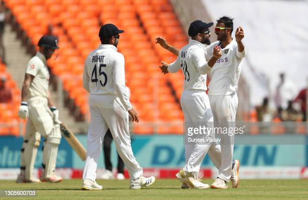 Axar Patel of India celebrates with Virat Kohli after taking the wicket of Ben Stokes of England during Day Three of the 4th Test Match between India...