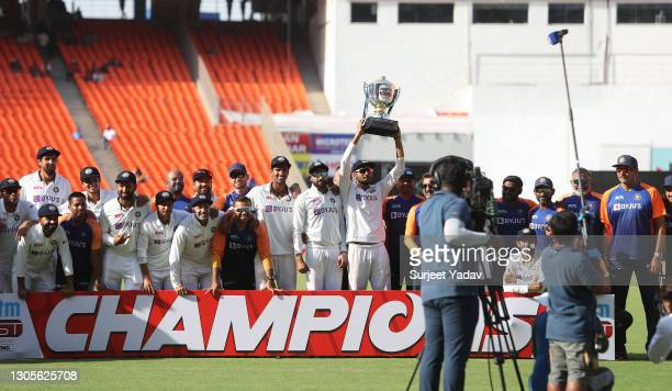 Axar Patel of India lifts the trophy with teammates after victory on Day Three of the 4th Test Match between India and England at the Narendra Modi...