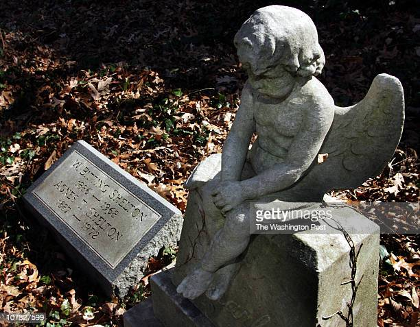 axcover9 030306 Mark Gail_TWP At the Ivy Hill Cemetery a cherub sits atop the tombstone of sevenyearold Charles Shelton who died in 1927