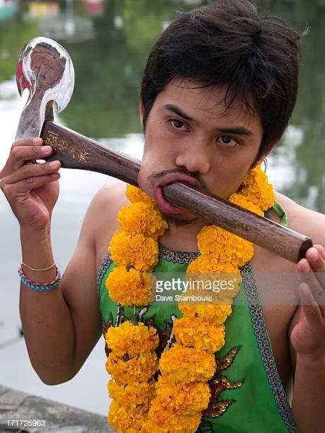 CONTENT] axe through the face at the bizarre Vegetarian Festival Phuket Thailand