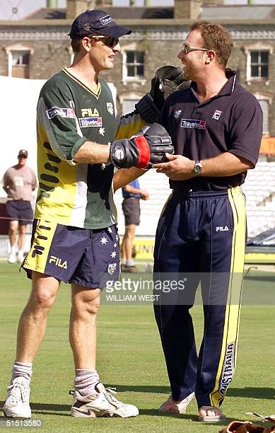 Axed Australian batsman Michael Slater is given encouragement by teammate Wade Seccombe on the eve of the fifth Test Match during training at the...