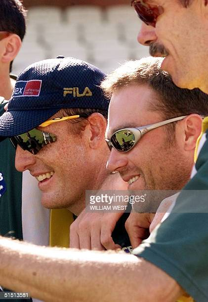 Axed Australian batsman Michael Slater poses with teammate Wade Seccombe and coach John Buchanan on the eve of the fifth Test Match during training...