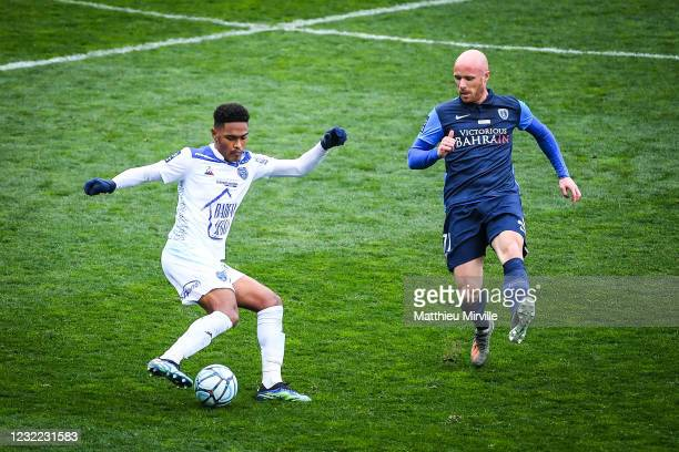 Axel BAMBA of Paris FC and Lenny PINTOR of Troyes during the Ligue 2 match between Paris FC and Troyes at Stade Charlety on April 10, 2021 in Paris,...