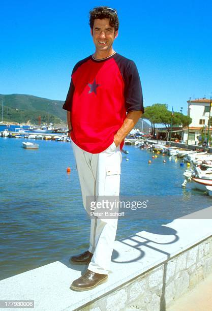 Axel Becker, Urlaub in der Toscana, Insel Elba, Italien, Europa, Meer, Motor-Boot, Boot, Hafen, Hafen-Mauer, Kai, Mauer, posieren, lächeln,...