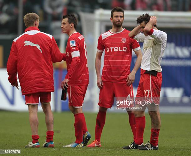 Axel Bellinghaus Robert Tesche Stylianos Malezas and Stefan Reisinger of Duesseldorf stand close on the pitch after the Bundesliga match between...