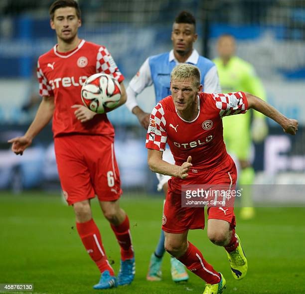 Axel Bellinghausen and Dustin Bomheuer of Duesseldorf and Martin Angha of 1860 Muenchen in action during the Second Bundesliga match between 1860...