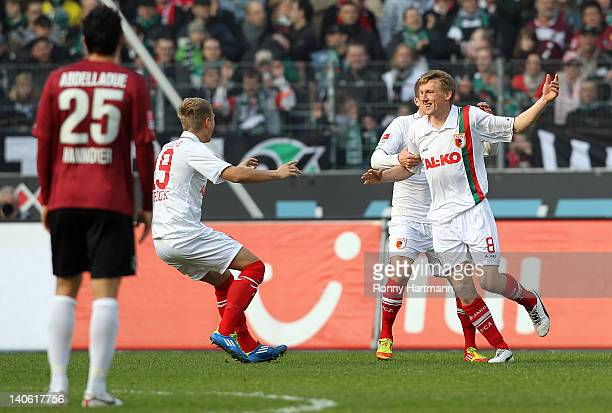 Axel Bellinghausen of Augsburg celebrates his teams first goal with teammates during the Bundesliga match between Hannover 96 and FC Augsburg at AWD...