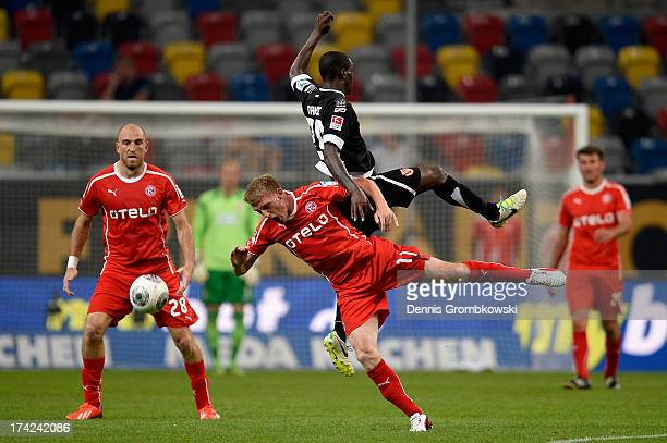 Axel Bellinghausen of Fortuna Duesseldorf and Charles Takyi of Energie Cottbus go up for a header during the Second Bundesliga match between Fortuna...