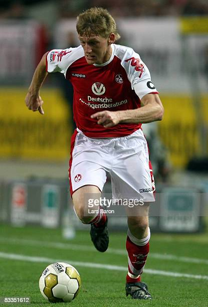 Axel Bellinghausen of Kaiserslautern runs with the ball during the Second Bundesliga match between 1 FC Kaiserslautern and RotWeiss Ahlen at the...
