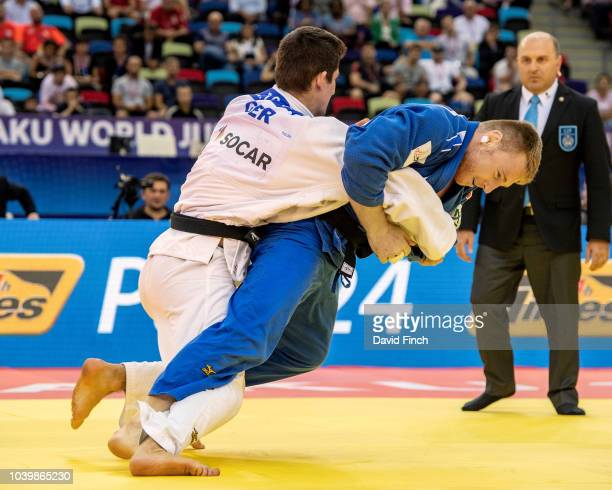 Axel Clerget of France attacks Eduard Trippel of Germany eventually winning the u90kg bronze medal contest by an ippon from a strangle submission...