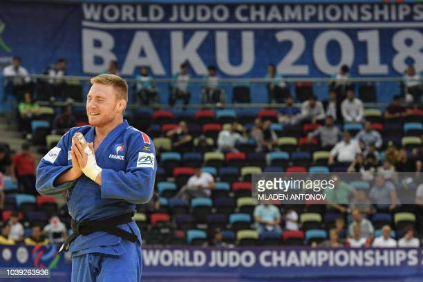 Axel Clerget of France celebrates his victory against Eduard Trippel of Germany in the men's under 90kg category bronze medal bout of the 2018 Judo...