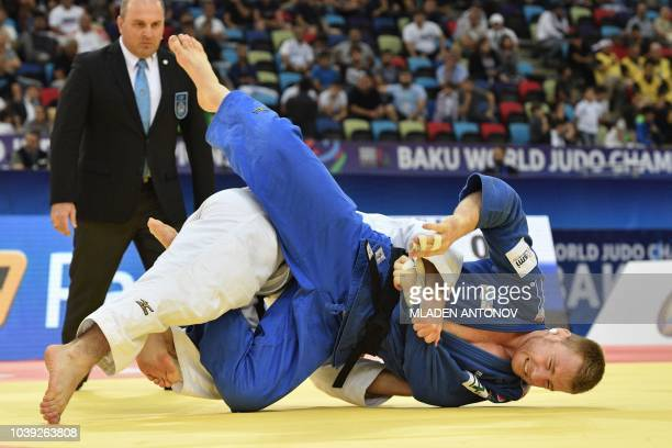 Axel Clerget of France fights with Eduard Trippel of Germany in the men's under 90kg category bronze medal bout of the 2018 Judo World Championships...