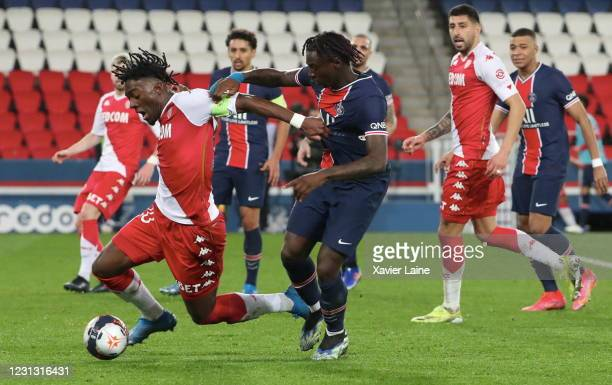 Axel Disasi of AS Monaco in action with Moise Kean of Paris Saint-Germain during the Ligue 1 soccer match between Paris Saint-Germain and AS Monaco...