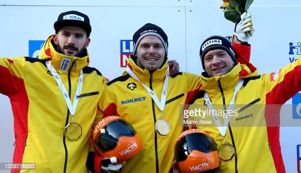 Axel Jungk , Christopher Grotheer and Alexander Gassner of Germany celebrate after the fourth heat for the Men's Skeleton on day eight of the BMW...