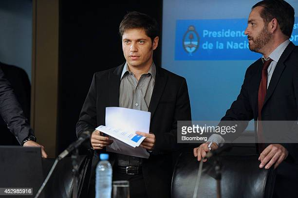 Axel Kicillof economy minister for Argentina left arrives to speak about the country's missed bond payment during a news conference in Buenos Aires...