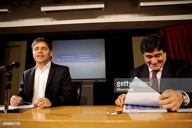 Axel Kicillof economy minister for Argentina left smiles during a news conference with Carlos Zannini Argentina's legal secretary in Buenos Aires...