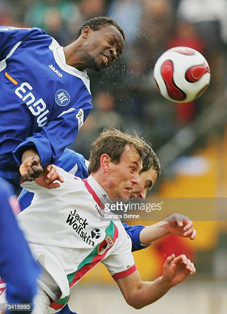 Axel Lawaree of Augsburg and Godfried Aduobe of Karlsruher SC jump for a header during the Second Bundesliga match between FC Augsburg and Karlsruher...