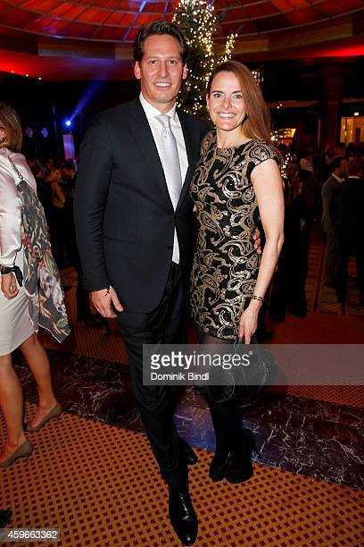 Axel Ludwig and Daniela Vukovic attend the Swarovski Christmas Party 2014 at Hotel Vier Jahreszeiten on November 27 2014 in Munich Germany
