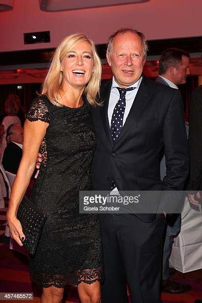 Axel Milberg and his wife Judith attend the Monti Memorial Charity Gala at Hotel Vier Jahreszeiten on October 18 2014 in Munich Germany