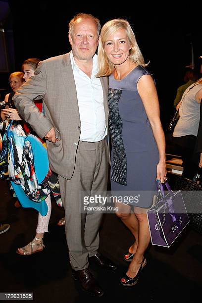 Axel Milberg and Judith Milberg attend the Laurel Show during the MercedesBenz Fashion Week Spring/Summer 2014 at Brandenburg Gate on July 4 2013 in...