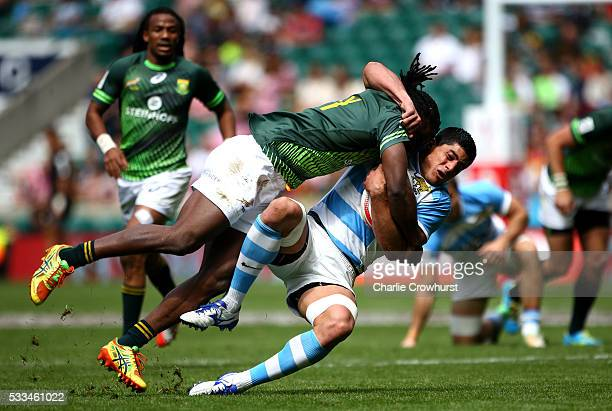 Axel Muller of Argentina is tackled by South Africa's Seabelo Senatla during the cup quarter final match between South Africa and Argentina during...