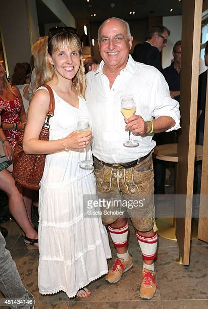 Axel Munz CEO Angermaier and his daughter Nina Munz during the opening of the Grey's Bar at H'Otello on July 20 2015 in Munich Germany