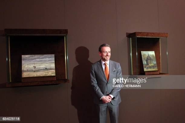 Axel Ruger director of the Van Gogh Museum in Amsterdam poses near the two recently recovered stolen paintings by late Dutch artist Vincent Van Gogh...