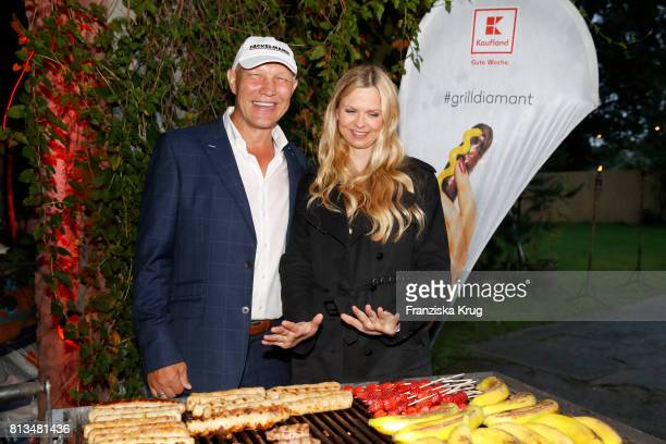 Axel Schulz and Britta Steffen attend the Kaufland Hosts VIP BBQ at OberhafenKantine on July 12 2017 in Berlin Germany