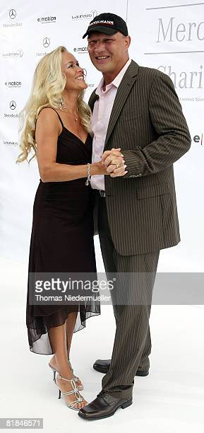 Axel Schulz and Patricia Reich attend the Laureus Charity Gala at the Mercedes Benz branch on July 7 2008 in Stuttgart Germany