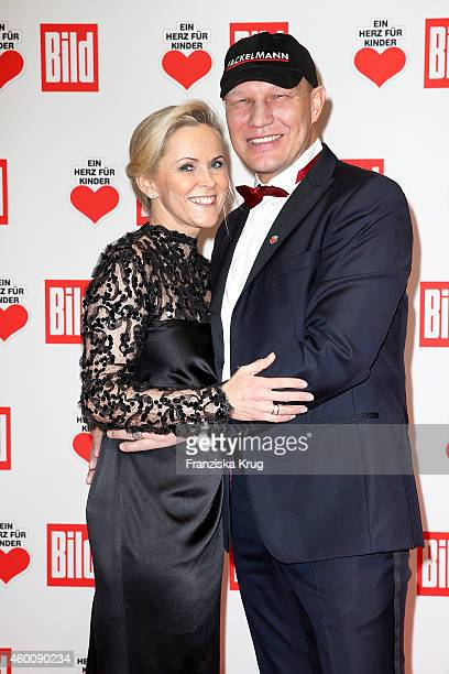 Axel Schulz and Patricia Schulz attend the Ein Herz Fuer Kinder Gala 2014 Red Carpet Arrivals on December 6 2014 in Berlin Germany