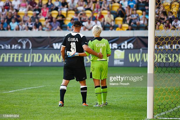 Axel Schulz and Silke Rottenberg stand together during the Laureus Benefit Soccer Match for the Sport For Good Foundation at the Gluecksgas Stadion...
