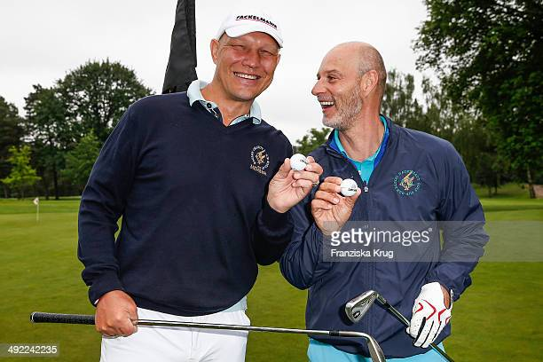 Axel Schulz and Simon Licht attend the 'Camp David Eagles Hauptstadt Golf Cup' on May 19 2014 in Berlin Germany