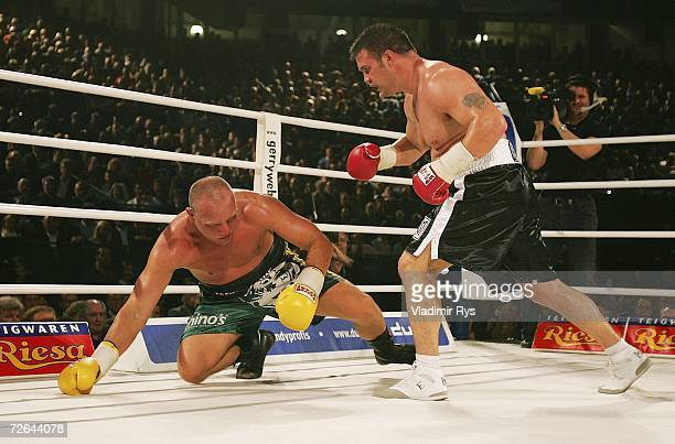 Axel Schulz falls down during the Heavyweight boxing match between Axel Schulz of Germany and Brian Minto of USA at the Gerry Weber Stadium on...