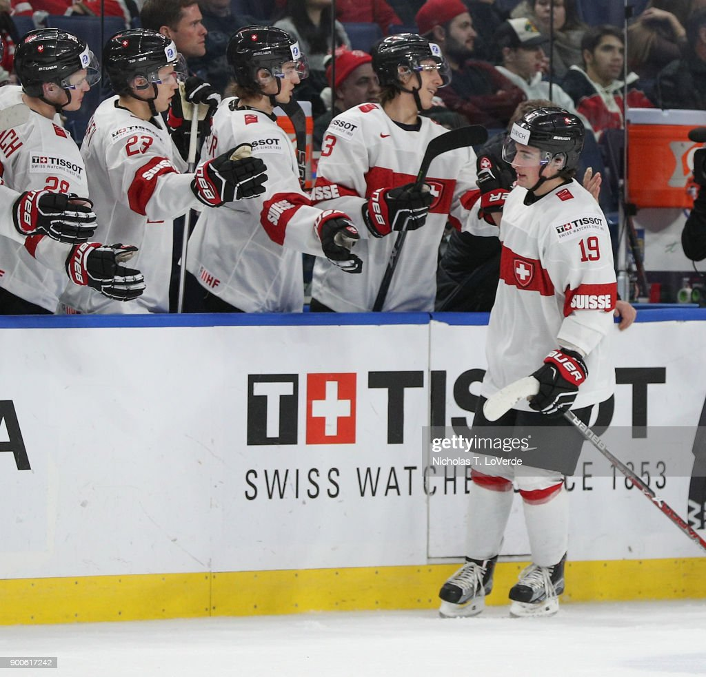 Axel Simic #19 of Switzerland celebrates with teammates after his goal reduced the deficit against Canada to 6-2 late in the third period of play in the Quarterfinal IIHF World Junior Championship game at the KeyBank Center on January 2, 2018 in Buffalo, New York.
