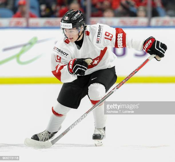 Axel Simic of Switzerland skates against Canada during the second period of play in the Quarterfinal IIHF World Junior Championship game at the...