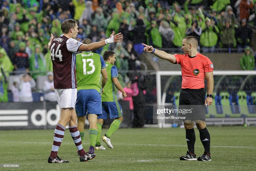 Axel Sjoberg #44, left, of the Colorado Rapids reacts to a foul that resulted in a penalty kick called by Referee Chris Penso during the second half of a match in the first leg of the Western Conference Finals at CenturyLink Field on November 22, 2016 in Seattle, Washington. The Sounders won the match 2-1.